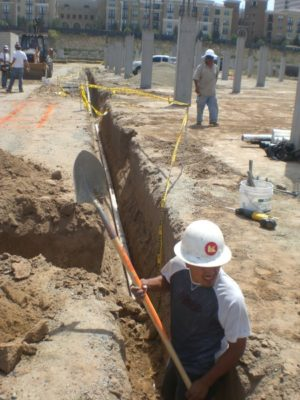 AMPAM team digging to lay plumbing pipes