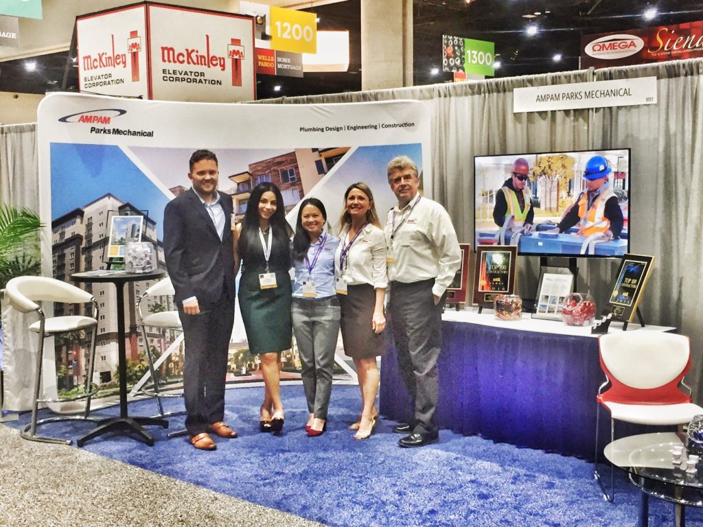 Sopann, Suzi Albrecht and Gary Fellhoelter in AMPAM's booth at PCBC.
