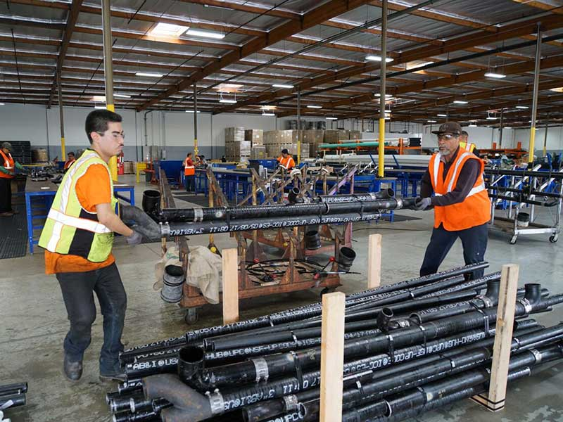 ampam-warehouse-crew-packing-plumbing-pipes